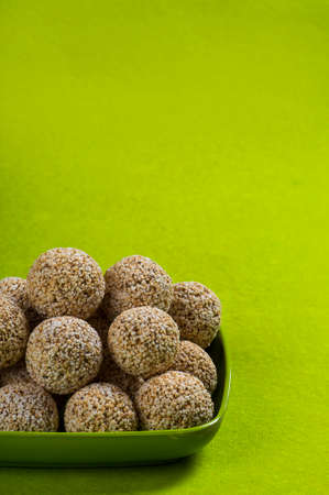 Amaranth or Rajgira laddu, Cholai ke laddo in green plate on green background