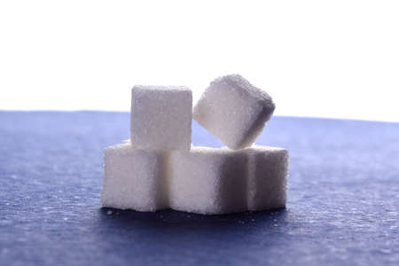 Close-up of Sugar Cubes on Blue Background