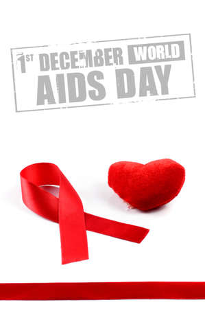 Aids ribbon and heart on white background.