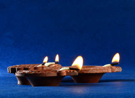 Clay diya lamps lit during diwali celebration. Greetings Card Design Indian Hindu Light Festival called Diwali Stock fotó