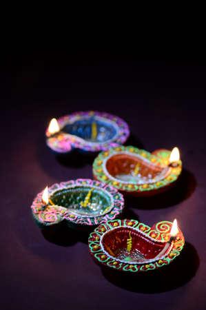 Colorful clay Diya (Lantern) lamps lit during Diwali celebration. Greetings Card Design Indian Hindu Light Festival called Diwali. Stock Photo