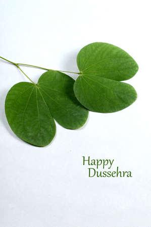 Indian Festival Dussehra, showing golden leaf on grey background. Greeting card. Stock Photo