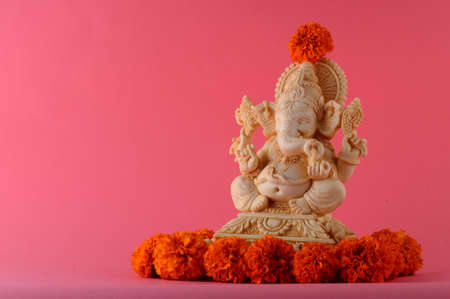 Hindu God Ganesha. Ganesha Idol on pink background
