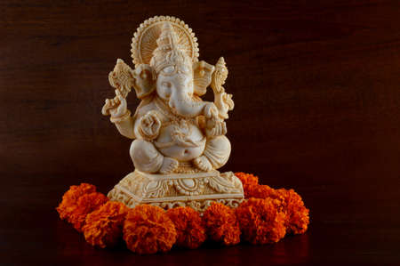 Hindu God Ganesha. Ganesha Idol on brown background Imagens