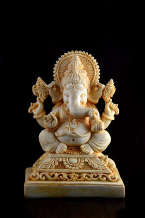 Hindu God Ganesha. Ganesha Idol on brown background Stock Photo - 136230219