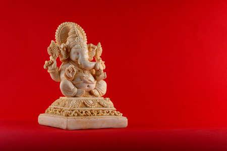 Hindu God Ganesha. Ganesha Idol on red background