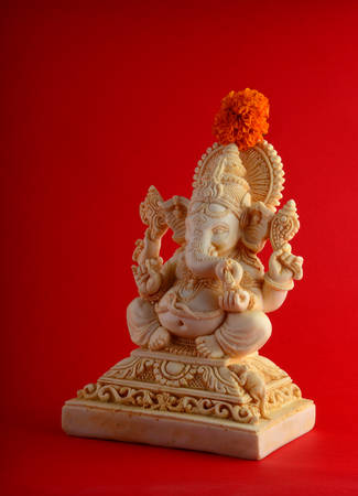 Hindu God Ganesha. Ganesha Idol on red background