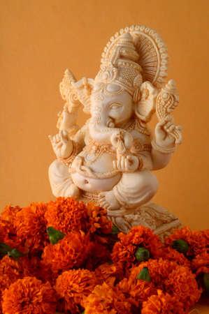Hindu God Ganesha. Ganesha Idol on yellow background