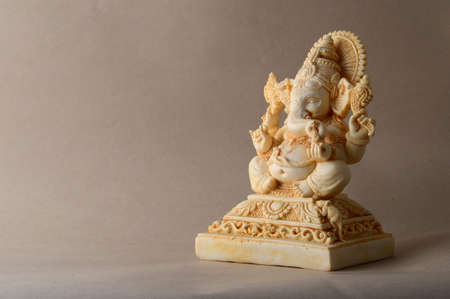 Hindu God Ganesha. Ganesha Idol on background