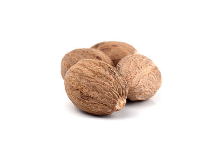 Nutmeg isolated on white background. Close up.