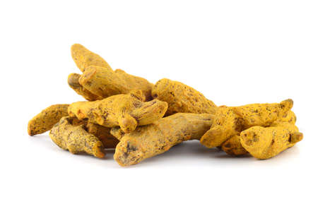 Dry Turmeric roots or barks isolated on white background Stock Photo