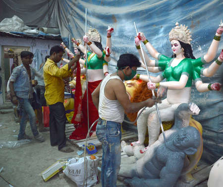 NAGPUR, MS, INDIA - OCT 12: An unidentified artist makes sculptures of goddess Durga on October 12, 2015 in Nagpur, Maharashtra, India. The idols are made for the Hindu festival of Dasara & navratri.