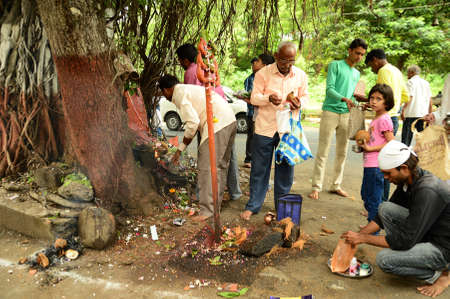 """NAGPUR, MAHARASHTRA, INDIA - AUGUST 01 : People worship of Snake God in """"Nag Panchami"""" festival. It is traditional worship of snakes or serpents observed by Hindus in Nagpur, India on 01 August 2014 Redakční"""