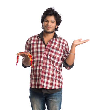 Young men showing rakhi in hand and giving expression on an occasion of Raksha Bandhan festival. Banque d'images