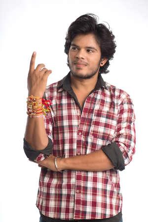 Young men showing rakhi on his hand on an occasion of Raksha Bandhan festival.