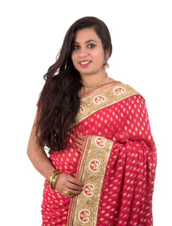 Beautiful young girl posing in Indian traditional saree on white background.