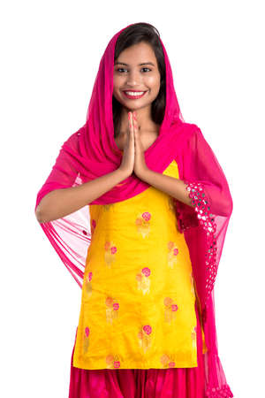 Beautiful Indian girl with welcome expression (inviting), greeting Namaste.