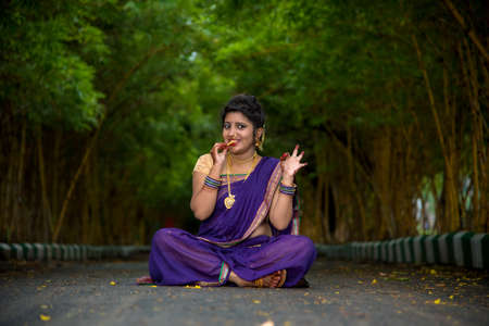 Indian Traditional Beautiful young girl in saree posing outdoors