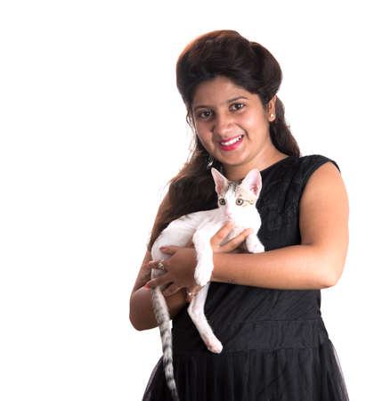 young attractive girl with cat on white background Фото со стока