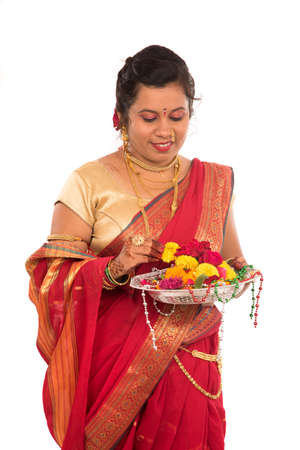 Beautiful Indian woman holding flower thali Stock Photo