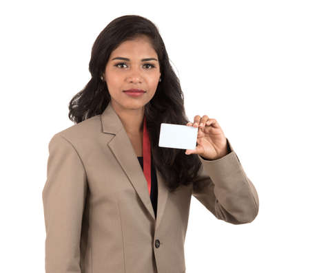 Smiling business woman holding a blank business card or ID card over white background Stock fotó