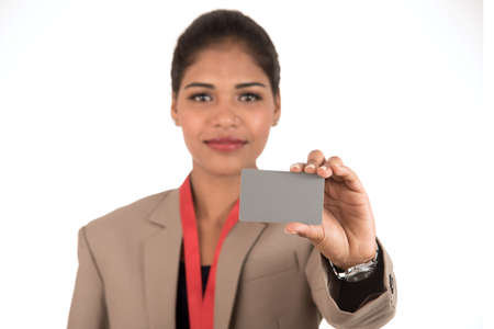 Smiling business woman holding a blank business card or ID card over white background
