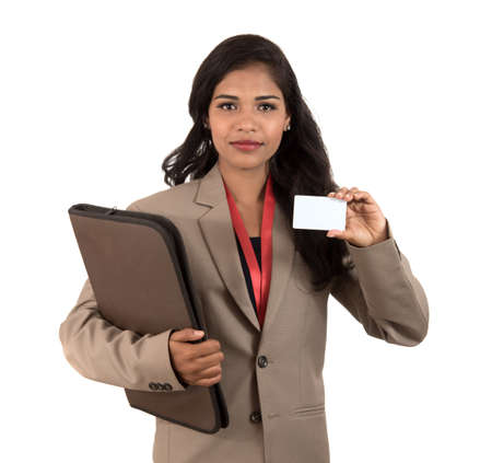 Smiling business woman holding a blank business card or ID card over white background Stock Photo