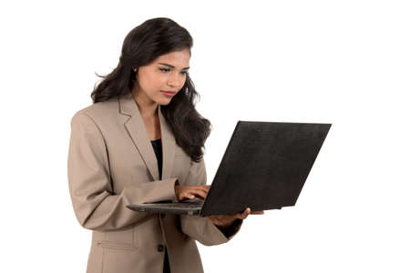 Young happy smiling woman holding laptop. Foto de archivo