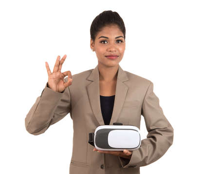 Young business woman holding & showing VR headset glasses device isolated on white background