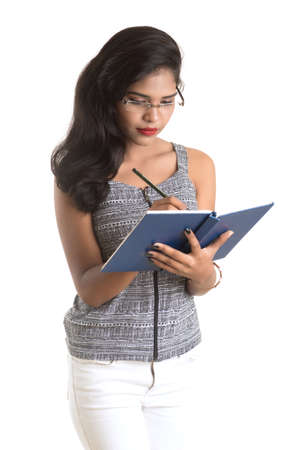 Pretty young girl holding book and posing on white background