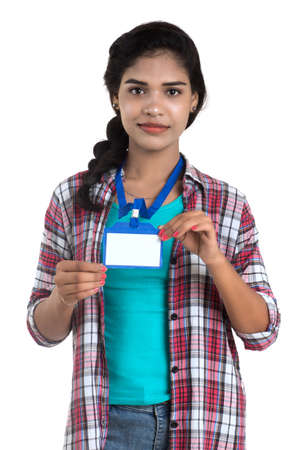 Young woman holding Identification white blank plastic id card.