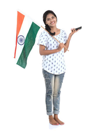Girl using mobile with Indian flag or tricolour on white background, Indian Independence day, Indian Republic day 版權商用圖片