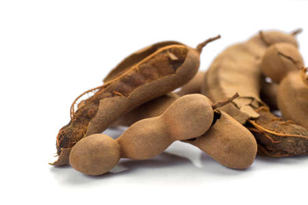 Tamarind isolated on white background. Sweet tamarind (Tamarind indica L.) Stock fotó - 155450781
