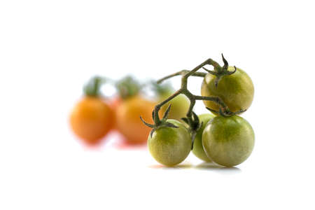 Close up of fresh cherry tomato isolated on white background. Stock fotó