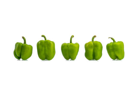 Fresh green bell pepper or capsicum on a white background