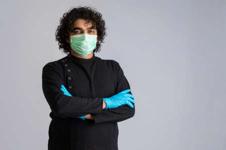 Closeup portrait of a young man wearing a medical or surgical mask