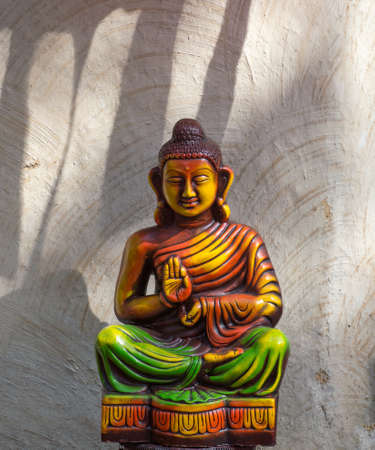 Statue of Buddha on abstract background