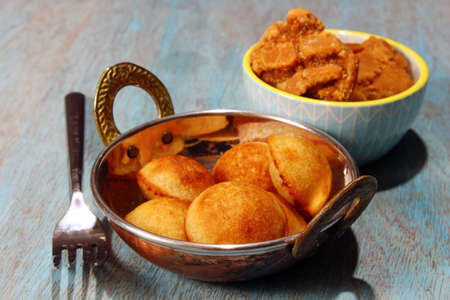 Sweet Paniyaram, a South Indian sweet made with lentils and rice batter with jaggery and coconut, selective focus