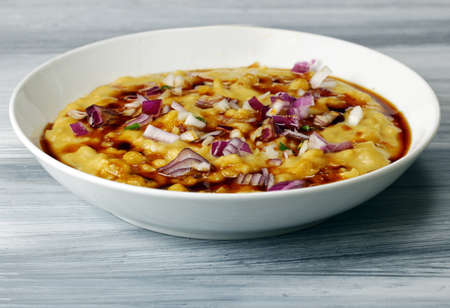 chaat: Martar Chaat or Ragda of Ragda Pattice with sweet tamarind chutney or sauce and onions Stock Photo