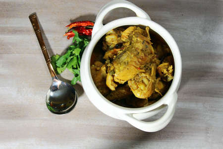 Indian Chicken curry in a bowl with copy space.