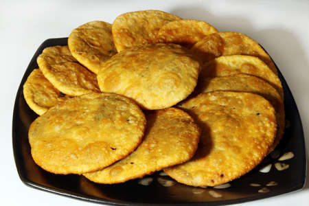 urad dal: Kacahuri or stuffed poori, an Indian bread stuffed with lentils and spices. Stock Photo