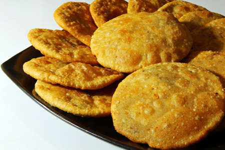 urad dal: Kacahuri or stuffed poori, an Indian bread stuffed with lentils and spices with copyspace