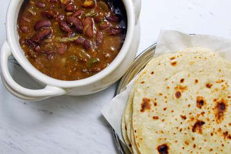 rajma: A bowl with Rajma and a plate of Kulchas