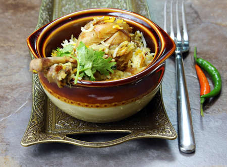 A bowl of Chicken Biryani an Indian rice meal with spicy Chicken marinated in yogurt. Stock Photo