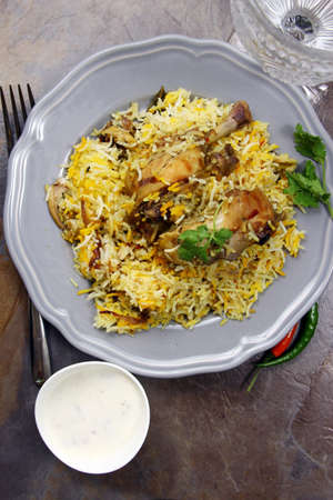 A plateful of Chicken Biryani an Indian rice meal with spicy Chicken marinated in yogurt with copy space, selective focus