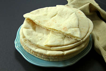 A stack of Pita bread on a plate
