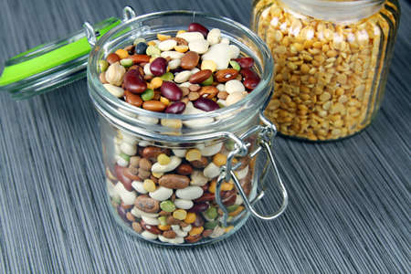 A jar full of all kinds of beans with selective focus Stock Photo