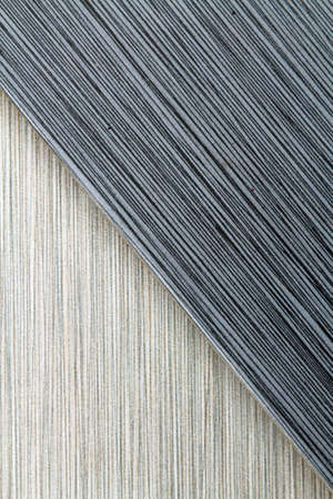nature photo: Textured grey and black striped background filling the frame, vertical version