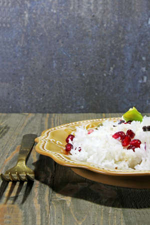 pommegranate: Cooked Basmati Rice with Pommegranate seeds, selective focus Stock Photo