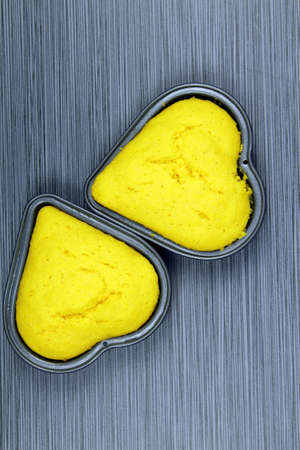plato del buen comer: Top view of heart shaped corn cakes on grey background